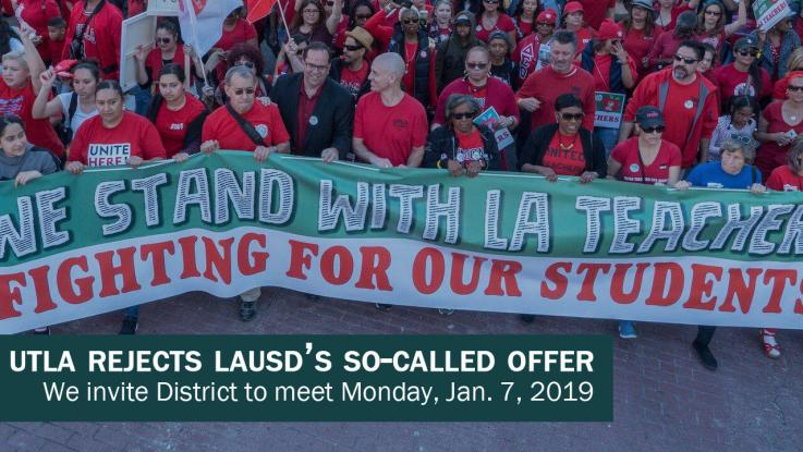 March4Ed photo of UTLA leaders and members marching with we stand with LA teachers fighting for our students banner.