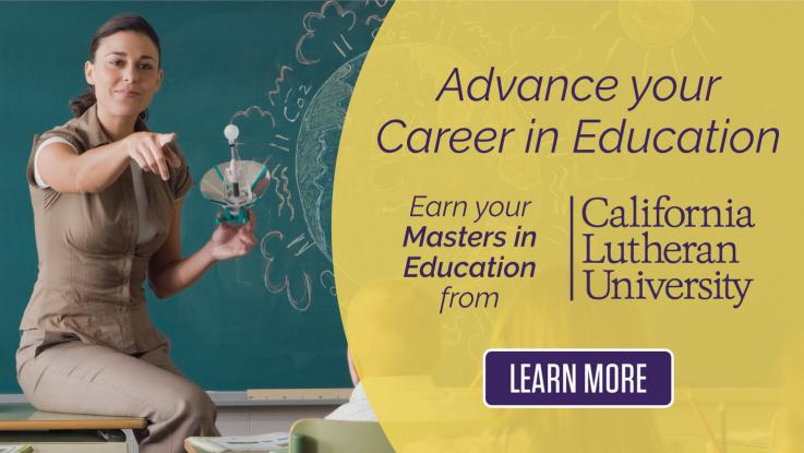 Cal Lutheran Advance your career in education. Earn your masters in Education. Female Teacher sitting on corner of a desk in front of a green chalkboard pointing her right arm out calling on a student while holding a light bulb in her left hand. There is some chalk writing on the board behind her with some cloud like drawings around a drawing of the world shaped like a globe.