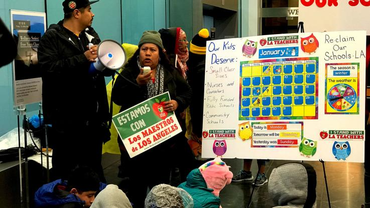 "On the first day of our strike, parents and community members (Maria Osorio on the mic, with ACCE organizer Cesar Castrejon) with Reclaim Our Schools LA stage a ""teach-in"" at the offices of Oaktree Capital Management to protest unchecked charter industry growth."