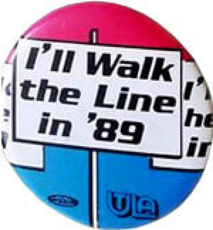 A vintage button from the 1989 Los Angeles teachers' strike. Red, white and blue that says in the middle I'll Walk the Line in 1989.