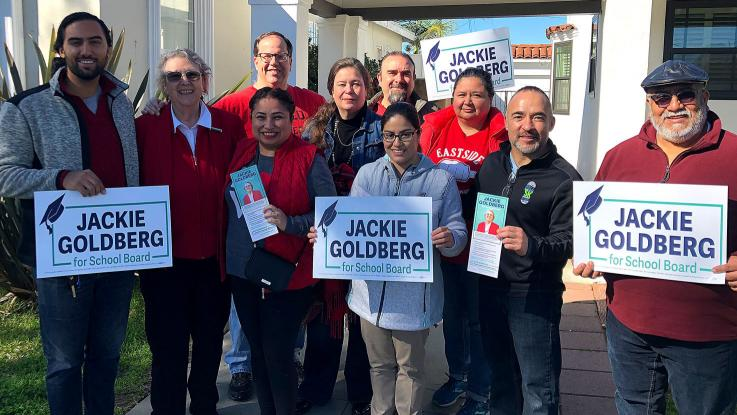 Alex (third from left) with a small group of people volunteering for Jackie Goldberg (second from left) holding  Jackie Goldberg for School Board lawn signs.