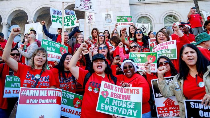 UTLA Members and supporters rally outside L.A. City Hall holding up picket signs during our #March4Ed rally and march, Saturday, Dec. 15, 2018.