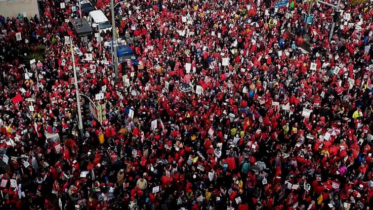 An overhead view of a large crowd with thousands of UTLA members, parents, students and community dressed in red gather in downtown Los Angeles during the UTLA strike in January 2019.