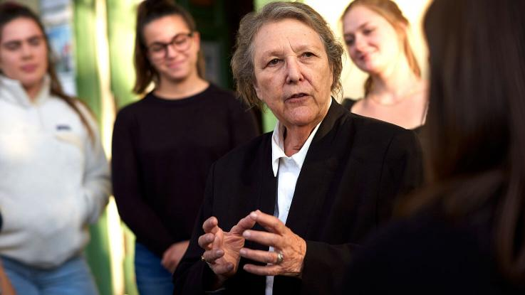 Jackie Goldberg is seen talking to female students.
