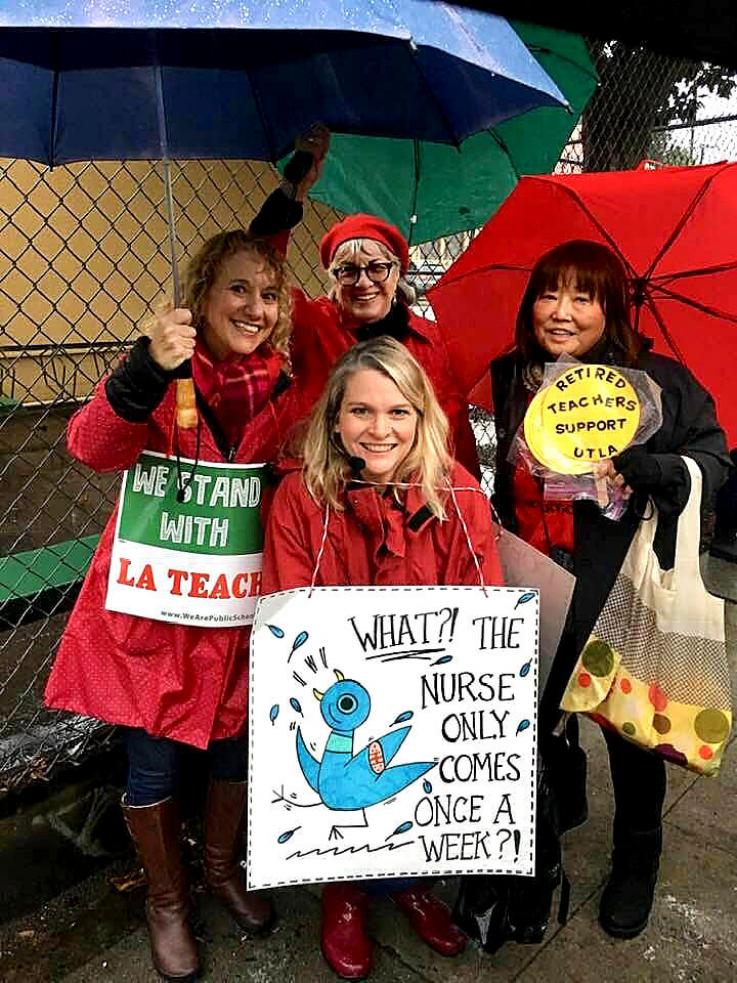 Retired teacher and UTLA-R member stands with other teachers and HHS staff during the teachers' strike in Los Angeles in January 2019.